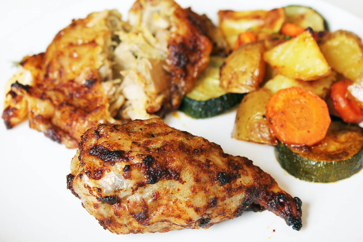 Vegan Chicken Drumsticks On Roasted Vegetables